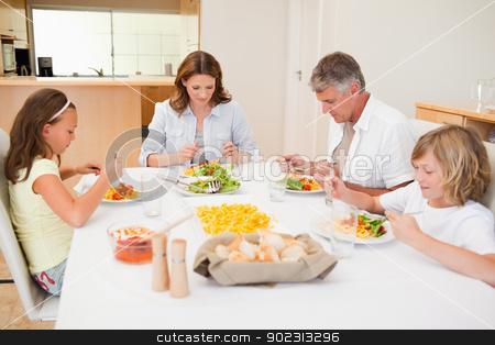 Family started having dinner stock photo, Family started having dinner together by Wavebreak Media