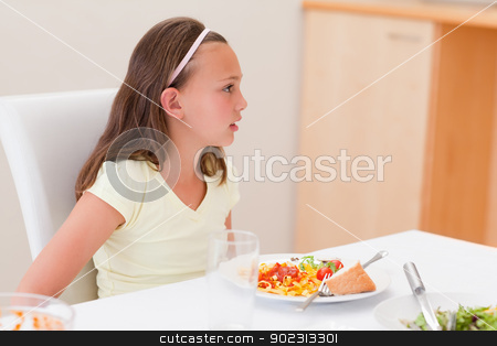 Girl with dinner at the table stock photo, Girl with her dinner at the table by Wavebreak Media