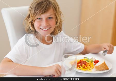 Smiling boy having dinner stock photo, Happy smiling boy having dinner by Wavebreak Media