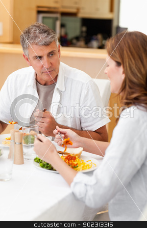 Man talking to wife during dinner stock photo, Man talking to his wife during dinner by Wavebreak Media