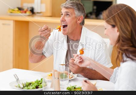 Married couple enjoying dinner stock photo, Married couple enjoying dinner together by Wavebreak Media
