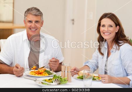 Smiling couple having dinner stock photo, Smiling couple having dinner together by Wavebreak Media