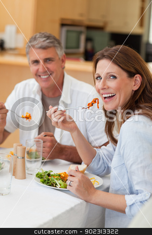 Happy couple eating dinner together stock photo, Happy smiling couple eating dinner together by Wavebreak Media