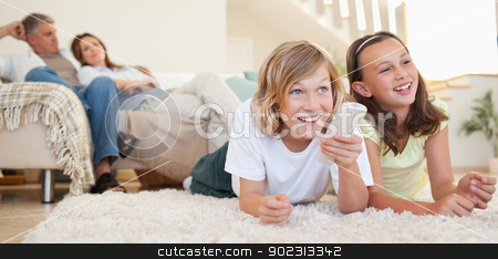 Siblings lying on the floor watching tv stock photo, Siblings lying on the floor watching tv together by Wavebreak Media