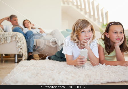 Siblings bored by tv program stock photo, Siblings are bored by tv program by Wavebreak Media