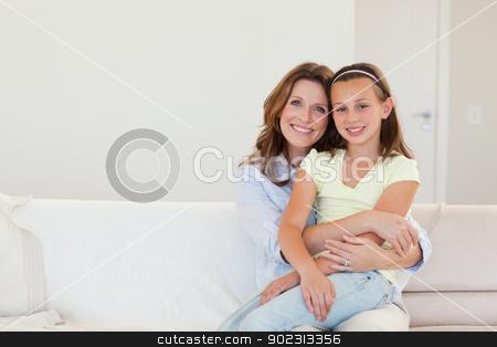 Smiling mother and daughter embracing stock photo, Happy smiling mother and daughter embracing by Wavebreak Media
