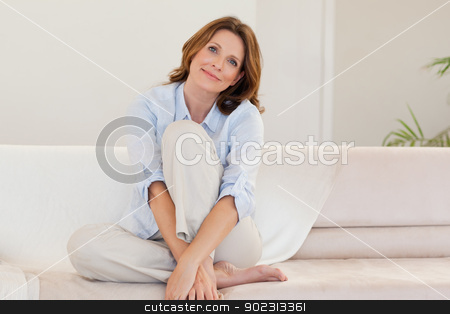 Mature woman on couch stock photo, Mature woman on the couch by Wavebreak Media