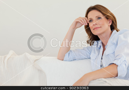 Mature woman in thoughts on couch stock photo, Mature woman in thoughts on the couch by Wavebreak Media