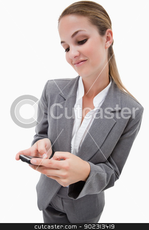 Portrait of a businesswoman using a smartphone stock photo, Portrait of a businesswoman using a smartphone against a white background by Wavebreak Media