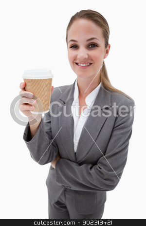 Portrait of a businesswoman holding a takeaway coffee stock photo, Portrait of a businesswoman holding a takeaway coffee against a white background by Wavebreak Media