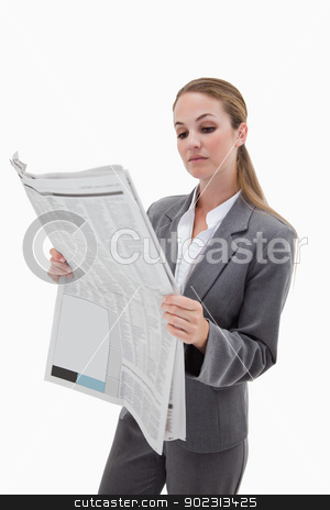 Portrait of a businesswoman reading the news stock photo, Portrait of a businesswoman reading the news against a white background by Wavebreak Media