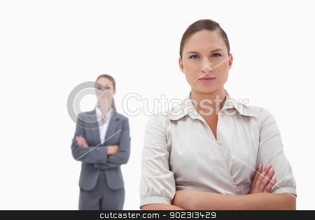 Two businesswomen posing stock photo, Two businesswomen posing against a white background by Wavebreak Media