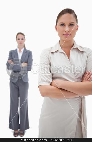 Portrait of serious businesswomen posing stock photo, Portrait of serious businesswomen posing against a white background by Wavebreak Media