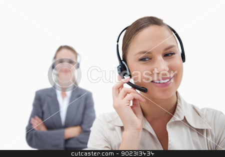 Operators with headsets stock photo, Operators with headsets against a white background by Wavebreak Media