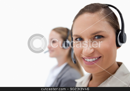 Sales persons using headsets stock photo, Sales persons using headsets against a white background by Wavebreak Media