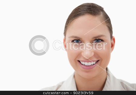 Close up of a businesswoman smiling at the camera stock photo, Close up of a businesswoman smiling at the camera against a white background by Wavebreak Media