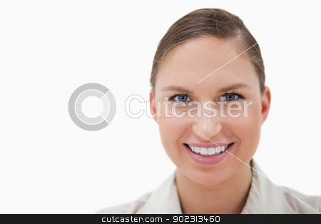 Close up of a young businesswoman smiling at the camera stock photo, Close up of a young businesswoman smiling at the camera against a white background by Wavebreak Media