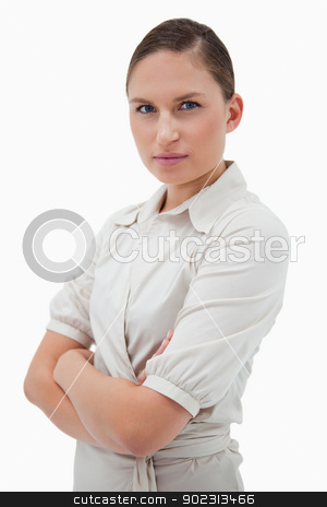 Portrait of a young businesswoman with the arms crossed stock photo, Portrait of a young businesswoman with the arms crossed against a white background by Wavebreak Media
