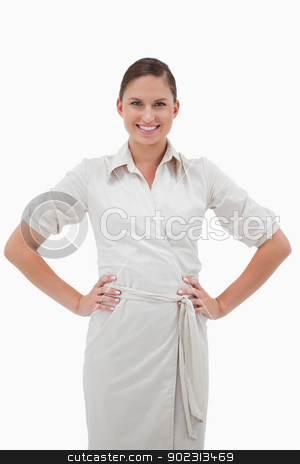 Portrait of a smiling businesswoman posing stock photo, Portrait of a smiling businesswoman posing against a white background by Wavebreak Media
