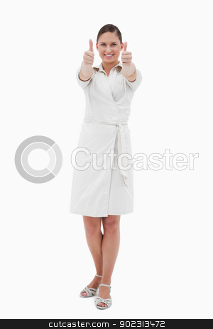 Portrait of a casual businesswoman with the thumbs up stock photo, Portrait of a casual businesswoman with the thumbs up against a white background by Wavebreak Media