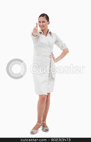 Portrait of a casual businesswoman with the thumb up stock photo, Portrait of a casual businesswoman with the thumb up against a white background by Wavebreak Media