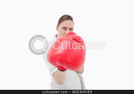 Serious businesswoman boxing stock photo, Serious businesswoman boxing against a white background by Wavebreak Media