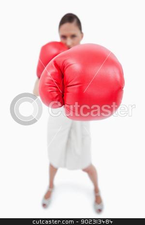 Portrait of a boxing businesswoman stock photo, Portrait of a boxing businesswoman against a white background by Wavebreak Media