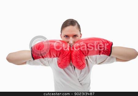 Businesswoman with boxing gloves stock photo, Businesswoman with boxing gloves against a white background by Wavebreak Media