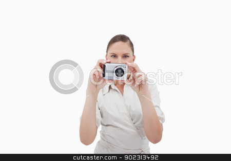 Businesswoman taking a picture stock photo, Businesswoman taking a picture against a white background by Wavebreak Media