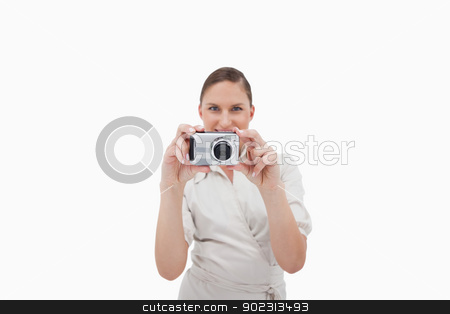 Smiling businesswoman taking a picture stock photo, Smiling businesswoman taking a picture against a white background by Wavebreak Media
