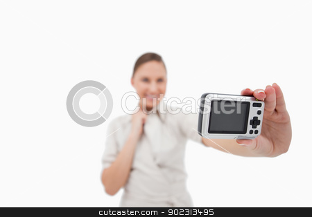 Businesswoman taking a picture of herself stock photo, Businesswoman taking a picture of herself against a white background by Wavebreak Media