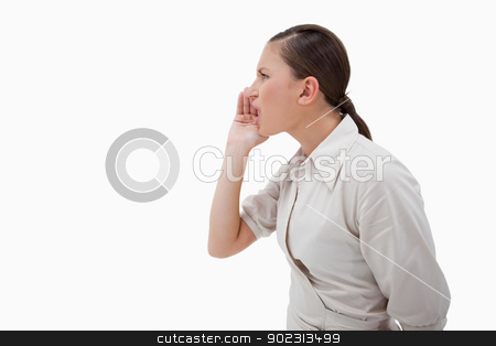 Side view of a businesswoman shouting stock photo, Side view of a businesswoman shouting against a white background by Wavebreak Media