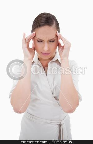 Portrait of a businesswoman having a headache stock photo, Portrait of a businesswoman having a headache against a white background by Wavebreak Media