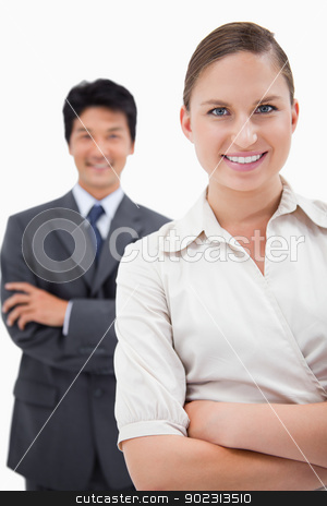 Portrait of smiling business people posing stock photo, Portrait of smiling business people posing with the arms crossed by Wavebreak Media