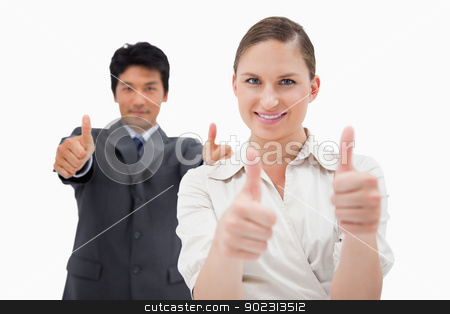 Business people with the thumbs up stock photo, Business people with the thumbs up against a white background by Wavebreak Media