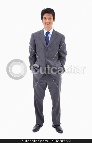 Portrait of a businessman standing up stock photo, Portrait of a businessman standing up against a white background by Wavebreak Media
