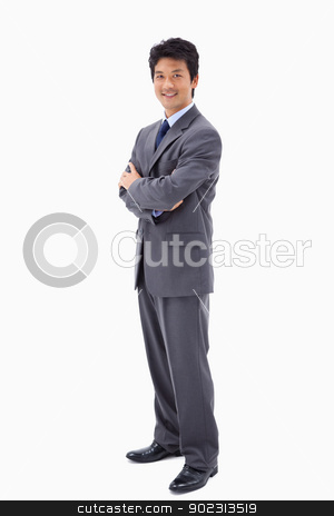 Portrait of a smiling businessman with the arms crossed stock photo, Portrait of a smiling businessman with the arms crossed against a white background by Wavebreak Media