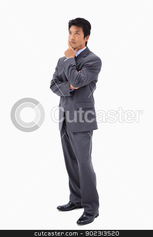 Portrait of a thoughtful businessman with the arms crossed stock photo, Portrait of a thoughtful businessman with the arms crossed against a white background by Wavebreak Media