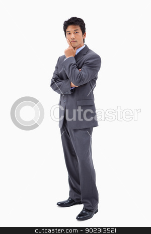 Portrait of a doubtful businessman with the arms crossed stock photo, Portrait of a doubtful businessman with the arms crossed against a white background by Wavebreak Media