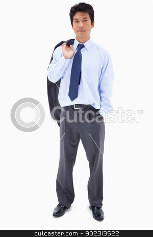 Portrait of a businessman with his jacket on his shoulder stock photo, Portrait of a businessman with his jacket on his shoulder against a white background by Wavebreak Media