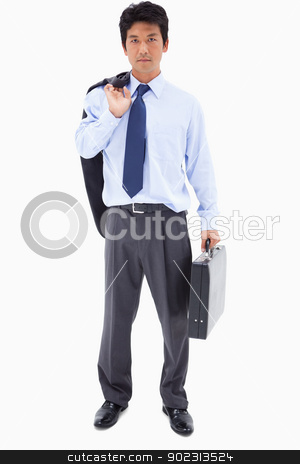 Portrait of a businessman holding a briefcase and his jacket ove stock photo, Portrait of a businessman holding a briefcase and his jacket over his shoulder against a white background by Wavebreak Media