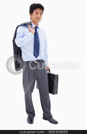 Portrait of a businessman holding a briefcase and his jacket on  stock photo, Portrait of a businessman holding a briefcase and his jacket on his shoulder against a white background by Wavebreak Media