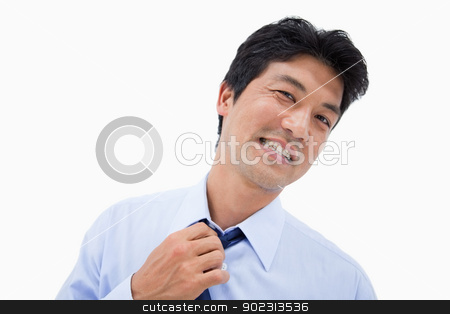 Businessman removing his tie stock photo, Businessman removing his tie against a white background by Wavebreak Media