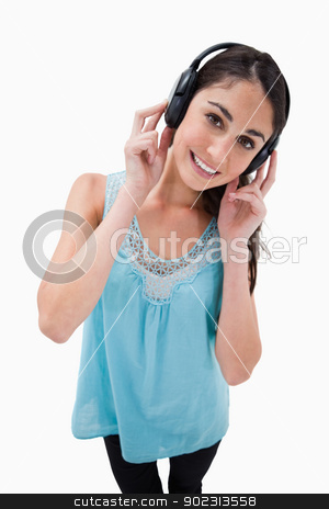 Portrait of a woman listening to music stock photo, Portrait of a woman listening to music against a white background by Wavebreak Media