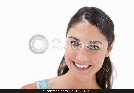 Close up of a smiling woman stock photo, Close up of a smiling woman against a white background by Wavebreak Media