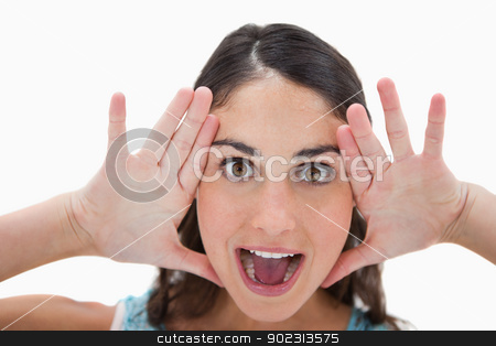 Excited woman shouting stock photo, Excited woman shouting against a white background by Wavebreak Media