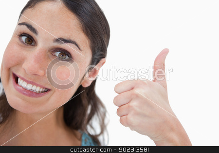 Woman with the thumb up stock photo, Woman with the thumb up against a white background by Wavebreak Media