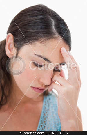 Portrait of a tired woman stock photo, Portrait of a tired woman against a white background by Wavebreak Media