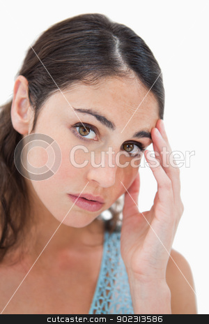Portrait of a sad woman looking at the camera stock photo, Portrait of a sad woman looking at the camera against a white background by Wavebreak Media