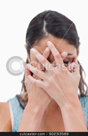 Portrait of a woman hiding her face stock photo, Portrait of a woman hiding her face against a white background by Wavebreak Media